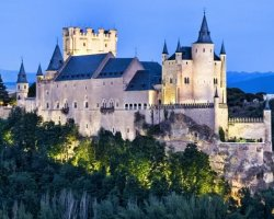 A fairytale castle, Alcazar of Segovia, Spain, Panoramic view by evening