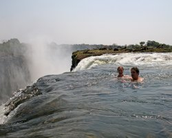 Dangerous Natural Pool Holiday, Devil Basin, Victoria Falls, Tourists swimming